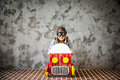 Child driving in a car made of cardboard box Royalty Free Stock Photo