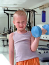 Child with dumbbell Royalty Free Stock Photography