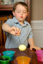Child dying eggs for easter Stock Image