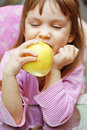 Child eating an apple Royalty Free Stock Photo