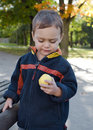 Child eating apple in park Royalty Free Stock Photo