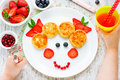 Child eating breakfast concept. Fun food for kids. Picture from Royalty Free Stock Photo