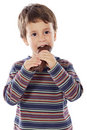 Child eating chocolate Stock Image