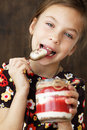 Child eating dessert portrait of a sweet homemade with berries Stock Image