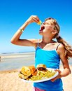 Child eating fast food at beach outdoor Royalty Free Stock Photography