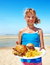 Child eating fast food at beach outdoor Stock Image