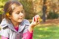 Child eating fresh apple
