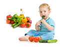 Child eating healthy food Stock Photos