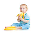 Child eating healthy food banana Stock Image