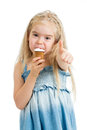 Child eating ice cream and showing okay Royalty Free Stock Photo