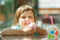 Child eating ice cream in summer years at outdoor cafe Royalty Free Stock Photos