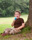 Child eating ice cream treat outdoors on hot summer day Royalty Free Stock Photos
