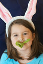 Child eating lettuce Stock Image