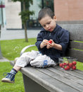Child eating strawberries Stock Images