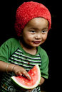 Child eating watermelon Royalty Free Stock Image