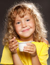 Child eating yogurt little happy Stock Image