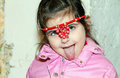 Child eats an apple lying Stock Photo