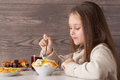 Child eats fruits in a cafe Royalty Free Stock Photo