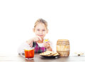 Child eats honey sitting at a wooden table Stock Images