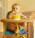 The child eats porridge Royalty Free Stock Photo