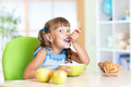 Child eats tasty breakfast Royalty Free Stock Photo