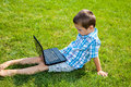 Child education little boy using laptop outdoors Stock Image