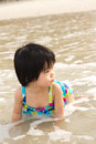 Child enjoy waves on beach Stock Photography