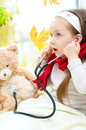 Child is examining her teddy bear Royalty Free Stock Photo