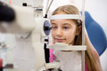 Child at eye specialist controls vision Royalty Free Stock Photo