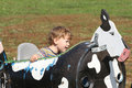 Child on a farm ride hayride having fun fall season Stock Photography