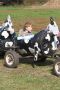 Child on a farm ride hayride having fun fall season Royalty Free Stock Photography