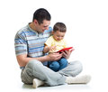 Child and father looking to play and read tablet computer dad Royalty Free Stock Images