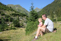 Child and father in the wild relaxing admiring view fagaras mountains Royalty Free Stock Images