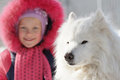 Child with a favourite dog white of samoyed Royalty Free Stock Photos