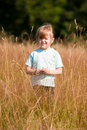 A child in the field. Royalty Free Stock Photography