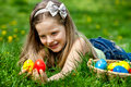 Child find easter egg outdoor happy Stock Images
