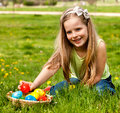 Child find easter egg outdoor happy Stock Photo