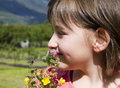 Child with flowers in the garden Royalty Free Stock Image