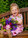 Child with flowers. Gift for Mothers Day Stock Photo