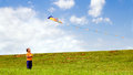Child flying kite Royalty Free Stock Images