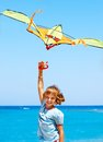 Child flying kite beach outdoor Stock Image