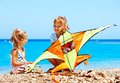 Child flying kite beach outdoor Royalty Free Stock Photography
