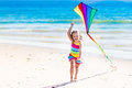 Child flying kite on tropical beach Royalty Free Stock Photo