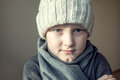 Child is freezing cold boy teen kid in warm hat and scarf and Royalty Free Stock Image