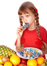 Child with fruit and vitamin pill. Royalty Free Stock Photo