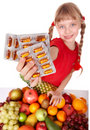 Child with fruit and vitamin pill. Royalty Free Stock Image