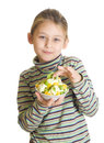 Child with a fruity dessert isolated on white background Royalty Free Stock Photos
