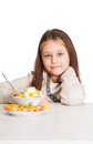 Child with a fruity dessert isolated on white background Stock Photo