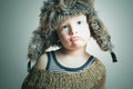 Child in fur hat fashion winter style little funny boy emotion children Royalty Free Stock Images