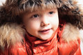 Child in fur hat and orange jacket fashion kid children close up winter style portrait of Stock Photography